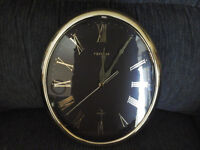 Nice gold and black wall clock with Roman numerals. Like new