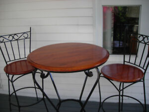 3 Piece bistro table and chairs for sale.
