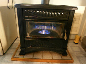 Deville oil stove, chimney and 200 gal. tank