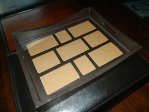 A NICE SERVING TRAY THAT HOLDS PICTURES