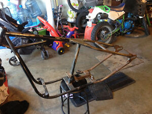 Rigid frame for shovel or evo
