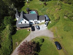 Beautiful farm house sitting on 53 acres of gorgeous land