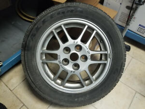 Like new all season tires and rims, worth over 1000$ each