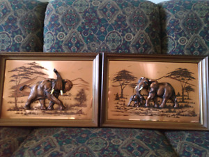 2 John Louw art pieces. Copper with ivory.
