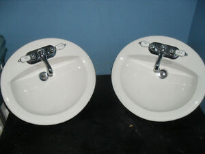 2 matching Ceramic sinks and faucets