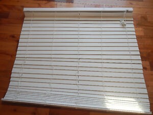23.5 horizontal faux wood blind.
