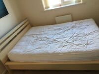 Wooden bed frame without mattress