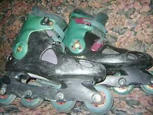 TWO OLD PAIRS OF ROLLER  BLADES Sarnia Sarnia Area image 1