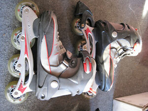 Two pairs of roller blades, size 7.5 and size 9