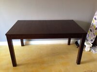 Brown dining room extendable table