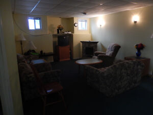 large room furnished.shared living area +kitchen,laundry $700