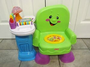 Petit chaise sonore lumineuse de Fisher-Price...EN ANG.