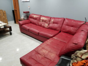 Red plastic leather couch