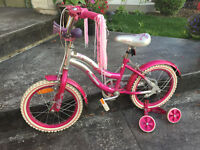 "12"" Girl Bike in excellent condition, Training wheel included"