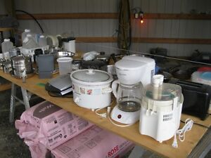 TABLE FULL OF KITCHEN STUFF,,,DISHES AND CROCH POT ETC