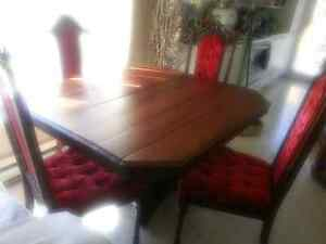 Antique dining table with four chairs