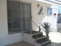 beautiful, quality  furnished mobile home in upscal 55+ park