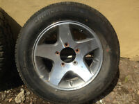2 TIRES FOR SALE 15 IN AND 16 IN RIMS included  1 Radial  PowerG