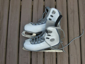 Size 7 women's CCM SP figure skates in good condition.