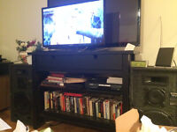 2 Samsung TV's... and one TV stand.