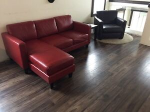 Small red couch and brown chair