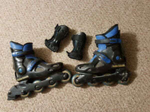 Size 6 Roller Blades, lightly used c/w wrist guards