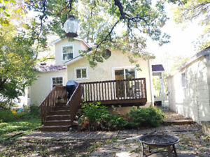 St. Vital RIVERFRONT Home - Affordable Purchase Price and Taxes