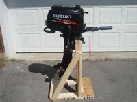 6hp Four Stroke Suzuki outboard fishing motor (Very Low hours)