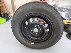 4 Winter tires on rims - size 185/65/R14
