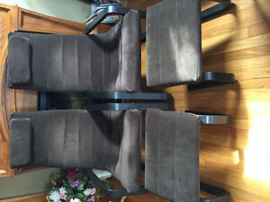 2 Ikea chairs with ottomans