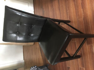 Four counter height dining chairs
