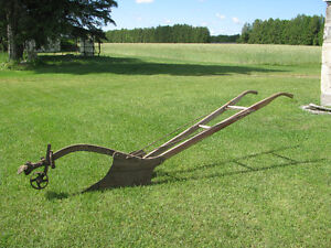 Antique horse plow. Always stored inside.