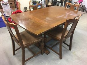 Antique draw leaf table with four chairs