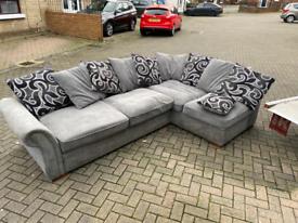 Grey material corner sofa