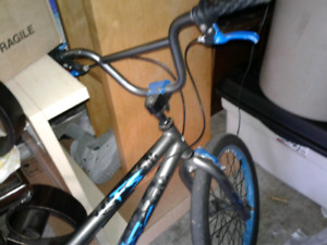 For sale bmx bike with nice blue rims.