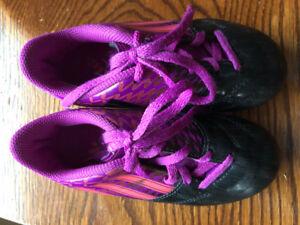 Girls black and purple addidas cleats.  Size 11.