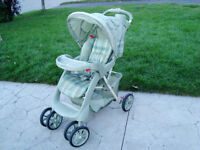 Full Size Graco Leaf Green Stroller with recline and sunshade