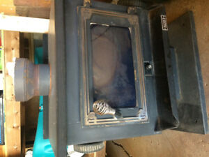 Wood burning stove (space heater)