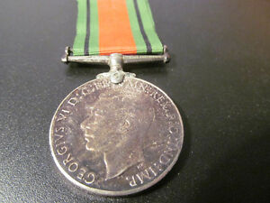 MILITARIA CANADIAN THE DEFENCE METAL 1939 - 1945