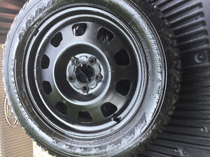 Rims and firestone snow tires off Nissan