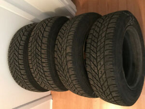 4 Goodyear Ultra Grip Winter Tires on Rims - Lot's of tread!