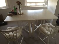 All white table and four chairs