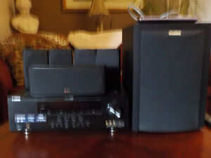 PolkAudio surround sound, 5 speakers, plus Whoofer & AM/FM tuner