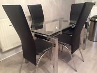 Glass and Chrome Dining Table with 6 Black and Chrome Chairs