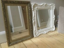 Two mirrors one plaster the other wood