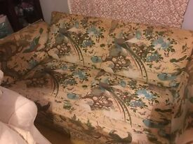 Sofa with feather-filled cushions