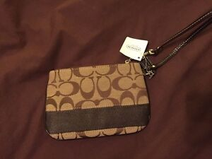 Coach wristlet brand new never used with original tag