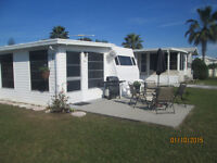 Trailer with large Florida room for sale.
