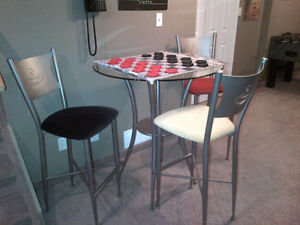 Glass Bistro Table and 4 colored chairs.