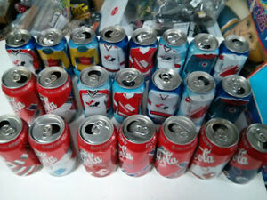 22 empty Coke and Pepsi cans Team Canada jerseys and NHL ones